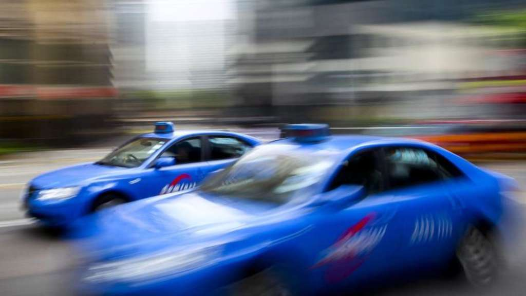 Blaue Taxis in Singapur. Foto: Stephen Morrison