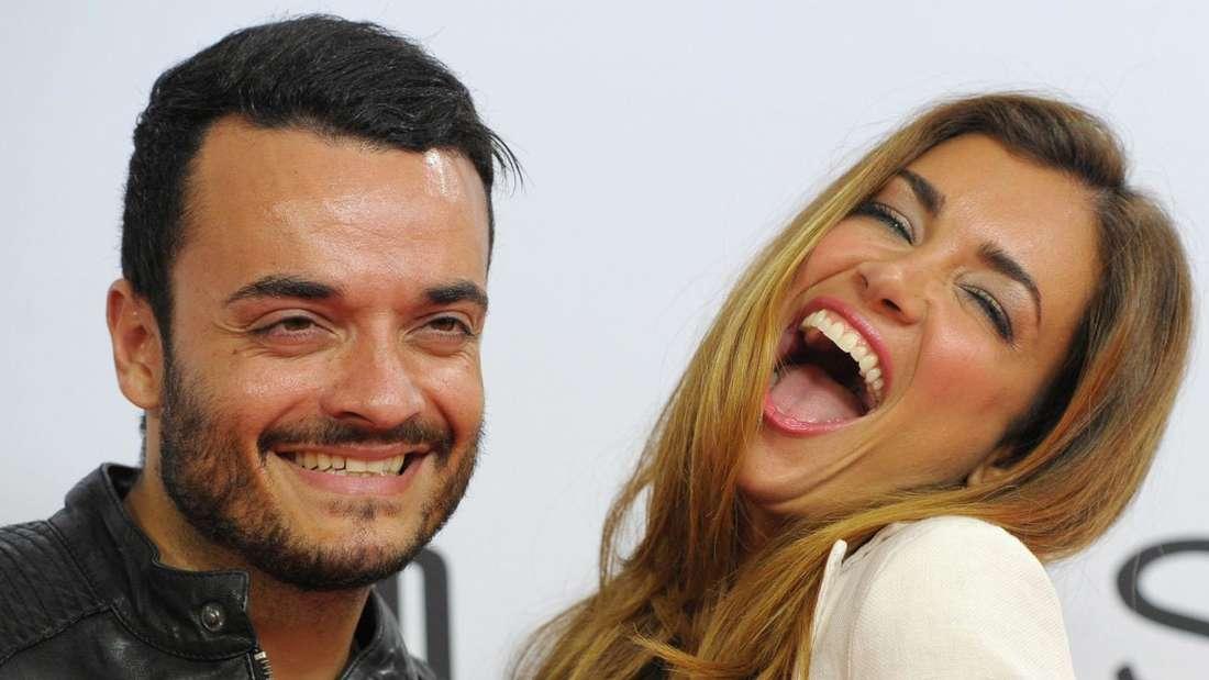 Giovanni Zarrella links, Jana Ina Zarrella rechts, die lauthals lacht