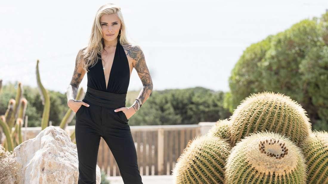 Sophia Thomalla in einem schwarzen Jumpsuit
