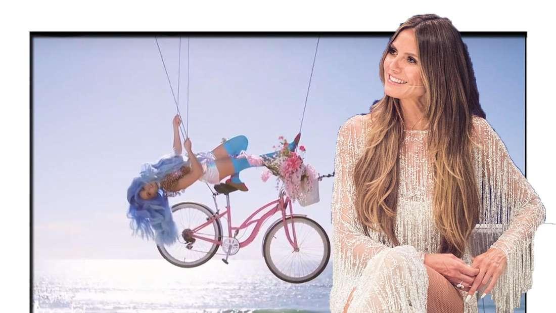 GNTM-Kandidatin hängt kopfüber auf einem Fahrrad in der Luft - Heidi Klum sitzt daneben