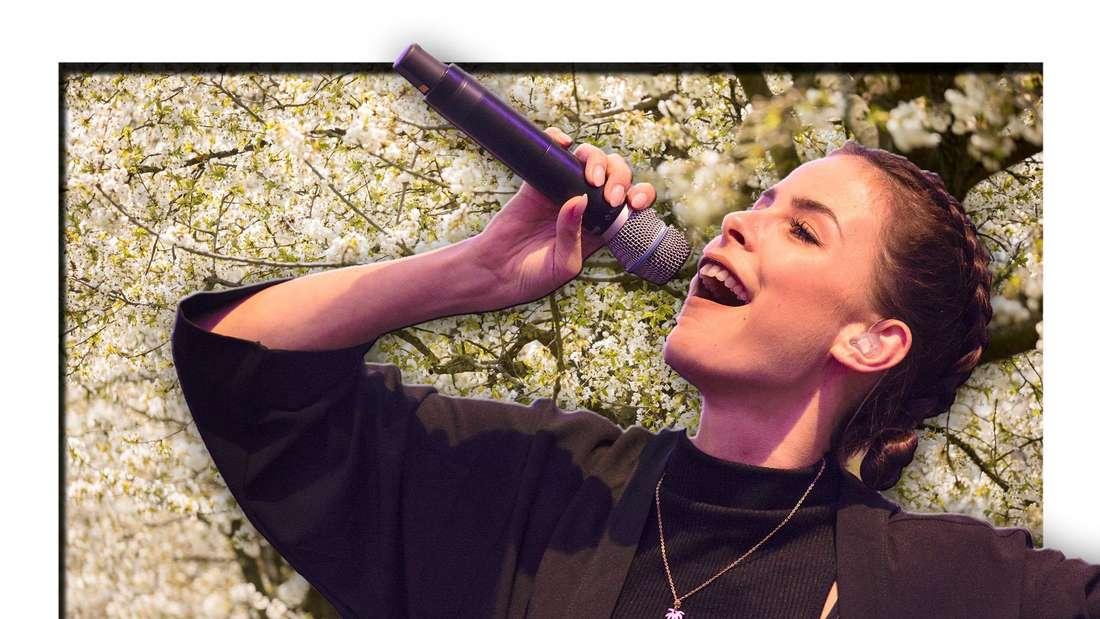Popsängerin Lena Meyer-Landrut steht vor Bäumen, die im Frühling blühen (Fotomontage)