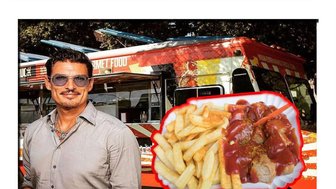 Chris Töpperwien neben seinem Currywurststand
