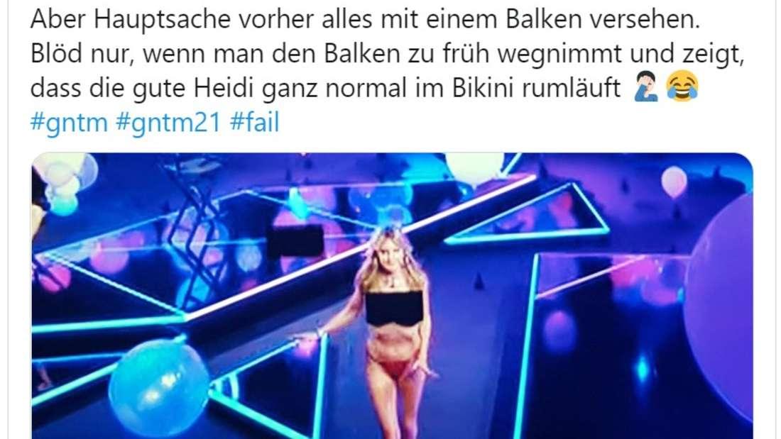 Heidi hat obenrum einen schwarzen Balken, der sie zensiert. Untenrum trägt sie ein Bikini-Höschen.