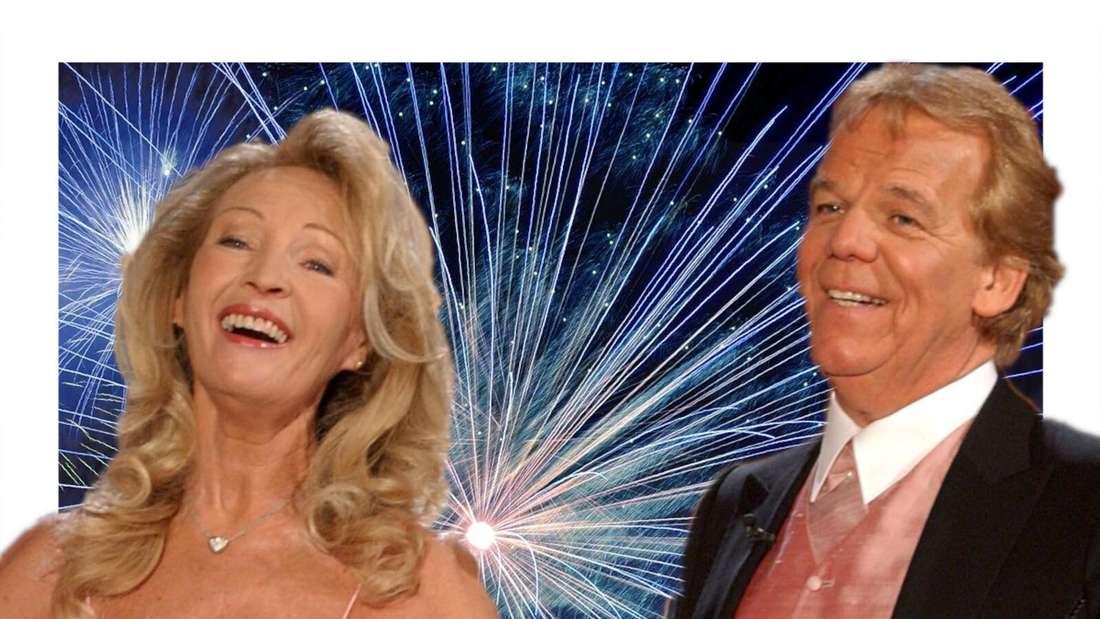 Judith und Mel lachen vor einem Hintergrund aus Feuerwerk (Fotomontage)