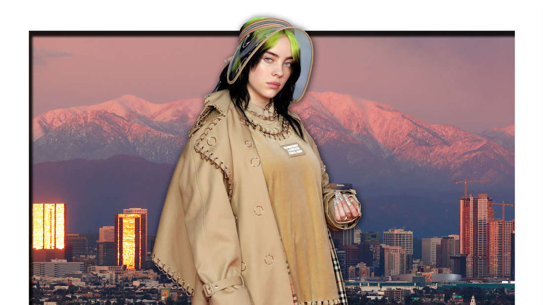 Popstar Billie Eilish steht vor der abendlichen Skyline der US-Metropole Los Angeles (Fotomontage)