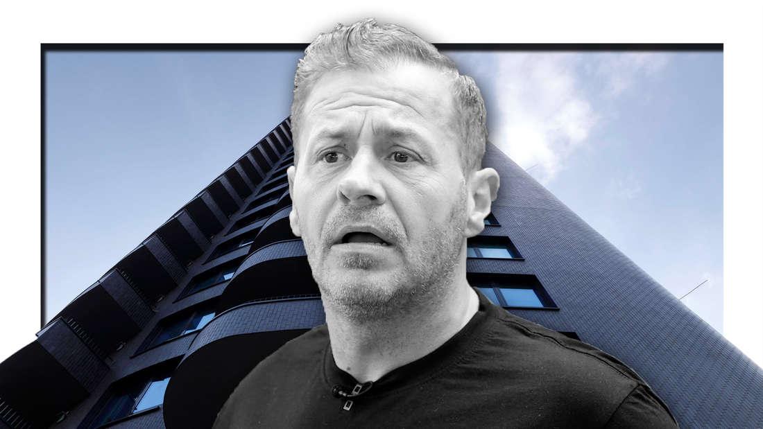 Willi Herren schaut entsetzt, ein Hochhaus (Fotomontage)