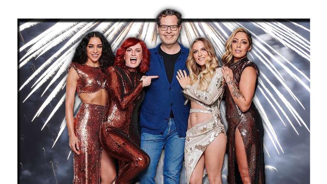 Die Girlgroup No Angels steht mit Produzent Christian Geller vor einem hellen Feuerwerk (Fotomontage)