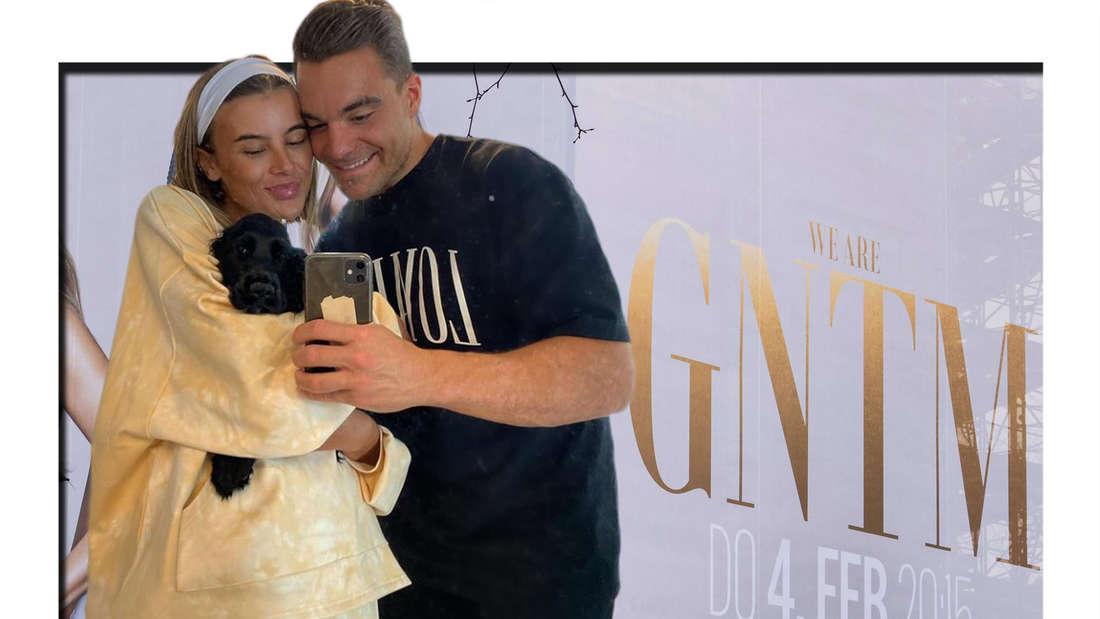 Fotomontage: Romina Palm und Stefano Zarrella mit kleinem Hund vor GNTM Plakat