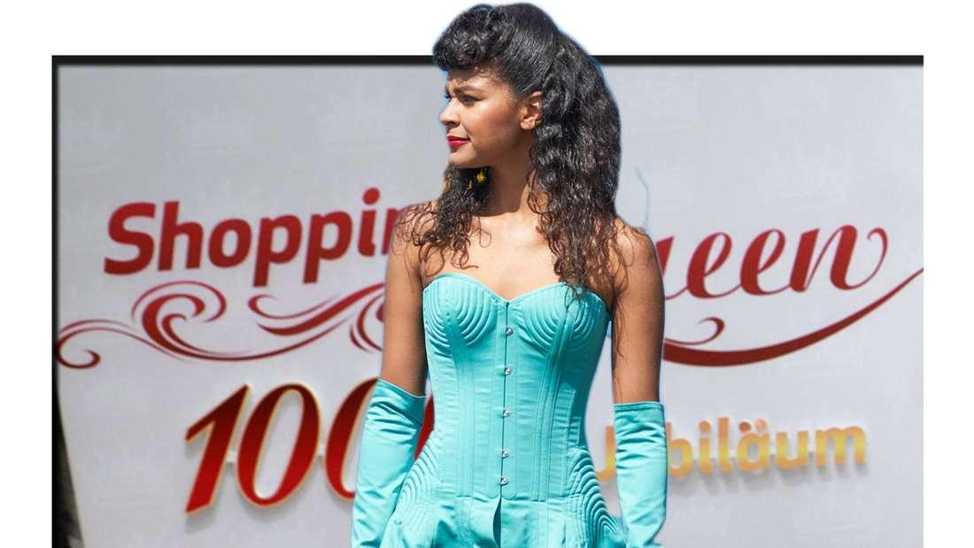 Fotomontage: Ex-GNTM-Kandidatin Lijana Kaggwa steht vor Shopping Queen Poster