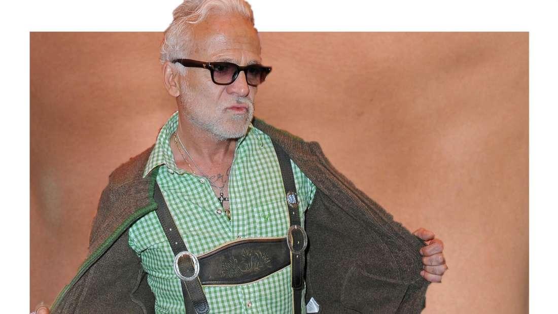 Nino de Angelo in Tracht-Kleidung und präsentiert eine schlanke Figur, im Hintergrund ist undeutlich ein Bauch zu erkennen. (Fotomontage)
