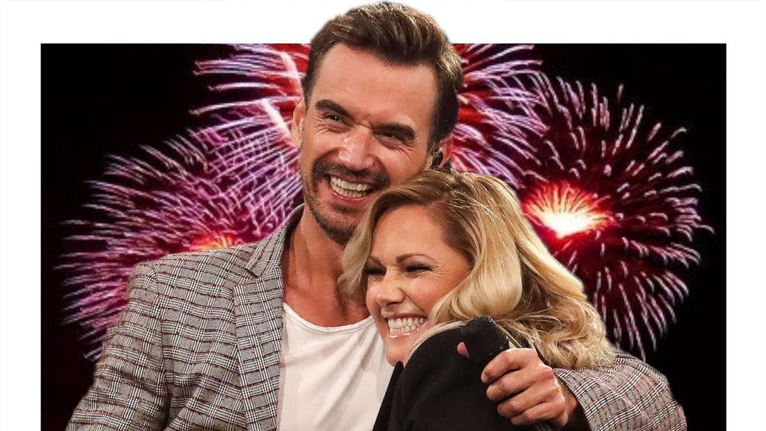 Helene Fischer  und Florian Silbereisen umarmen sich, im Hintergrund ein Feuerwerk. (Fotomontage)