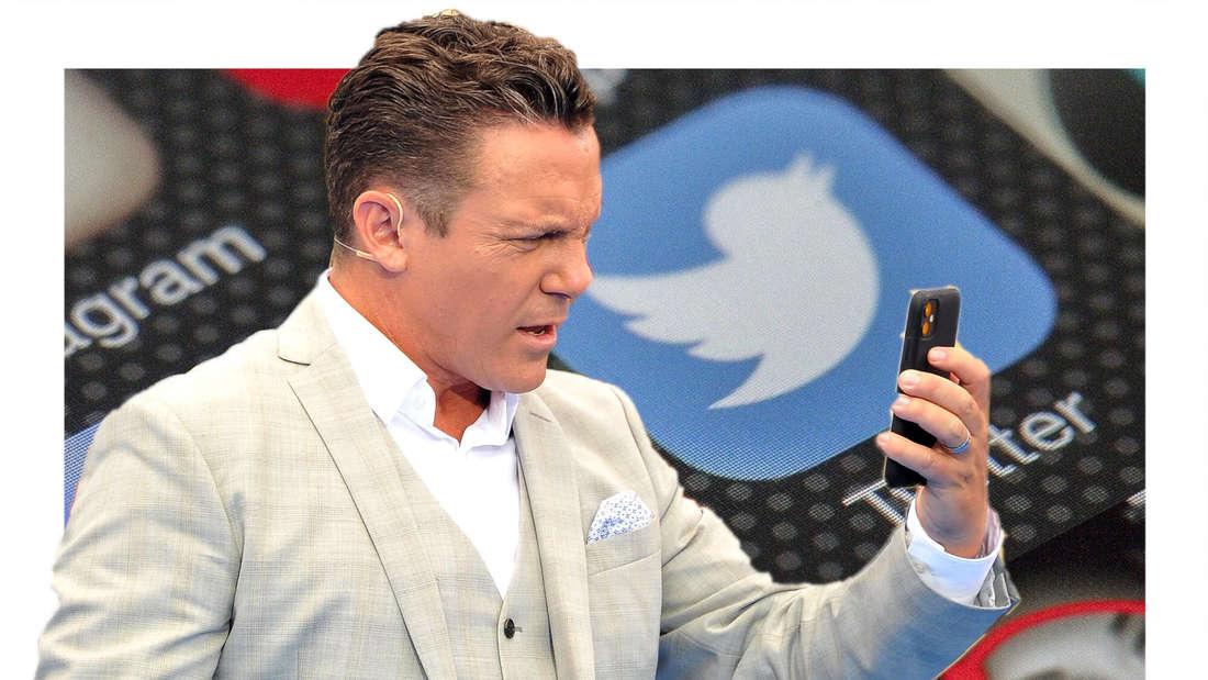 Stefan Mross schaut kritisch auf sein Handy. (Fotomontage)