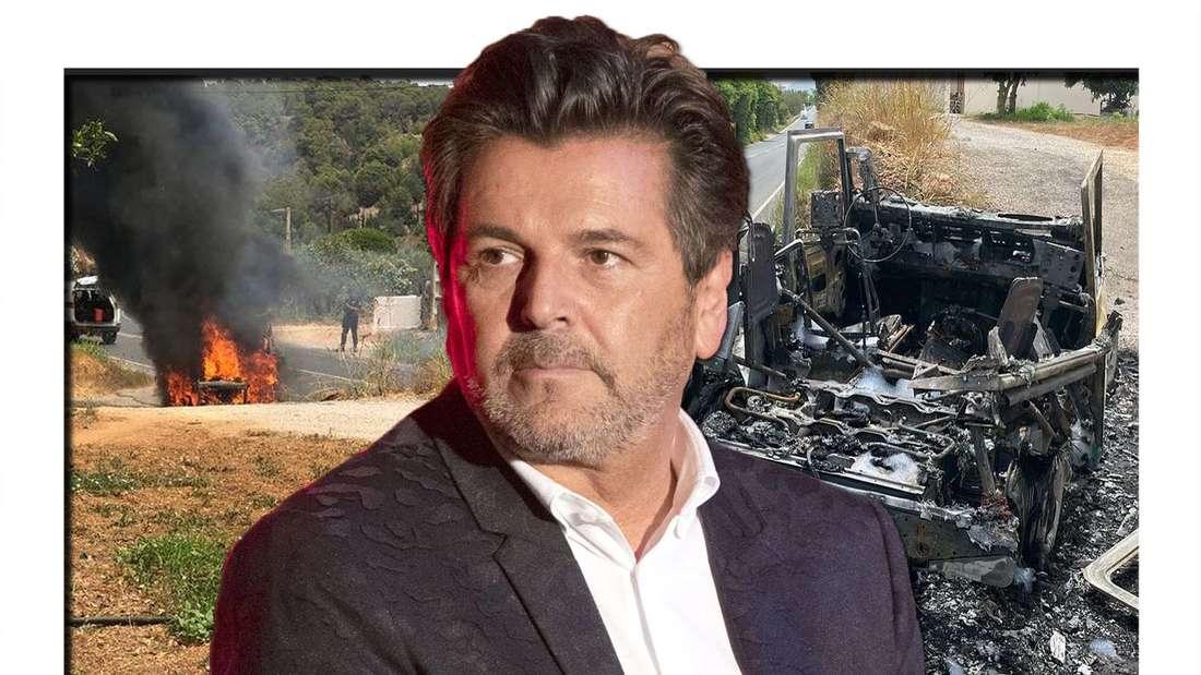 Thomas Anders schaut entsetzt zur Seite, im Hintergrund ein brennendes Auto
