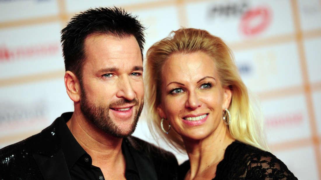 Michael Wendler und Claudia Norberg posieren für ein Event