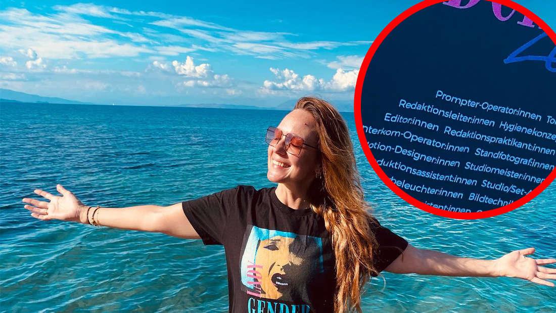 Carolin Kebekus steht am Meer und hat die Arme ausbreitet