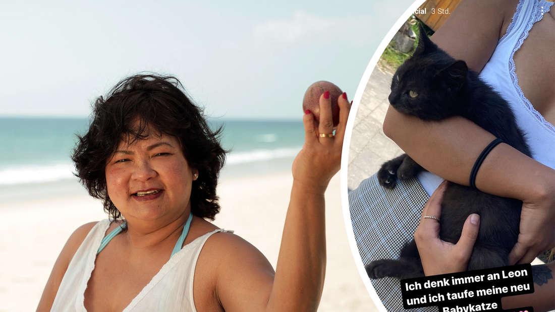 Narumol hält eine Kokosnus in der Hand, rechts hat sie den Kater im Arm