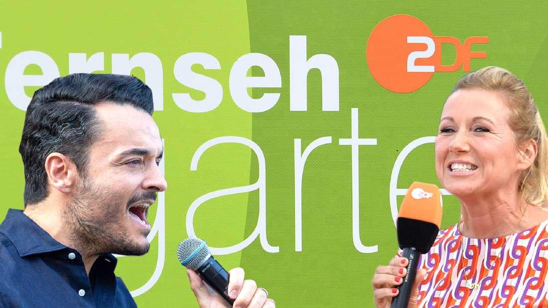 """Schlagersänger Giovanni Zarrella blickt zur linken Seite und singt in ein Mikrofon. ZDF-Moderatorin Andrea Kiewel grinst und hält ein Mikrofon in der Hand. Im Hintergrund ist das Logo vom """"ZDF-Fernsehgarten"""" zu sehen."""