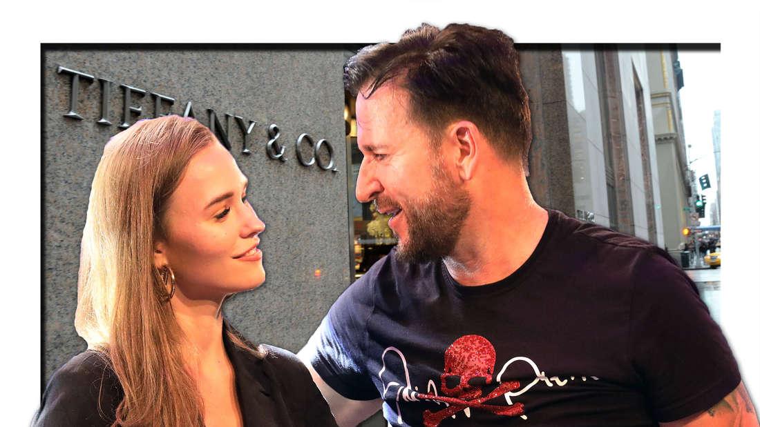 """Laura Müller und Michael Wendler lachen sich an, im Hintergrund Luxus-Laden """"Tiffany"""""""
